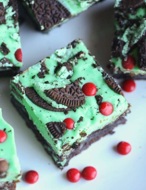 Grinch Brownies aka Mint Oreo Brownies... a fudgy brownie filled with Mint Oreo Cookies, topped with a minty, white chocolate ganache and more Oreos!