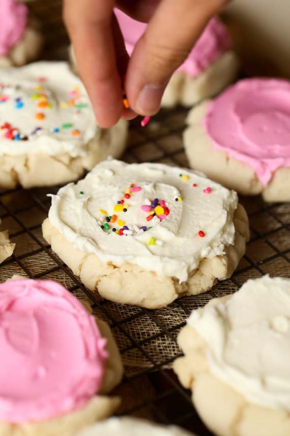 Pressed Sugar Cookies! Soft in the center, with lightly crunchy edges, piled with creamy frosting! Sorta kinda like the famous Swig Cookie!