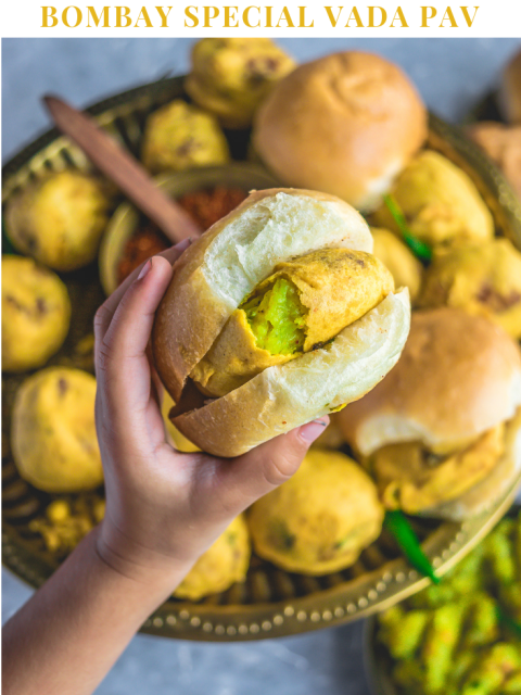 a hand holding a vada pav and text on top