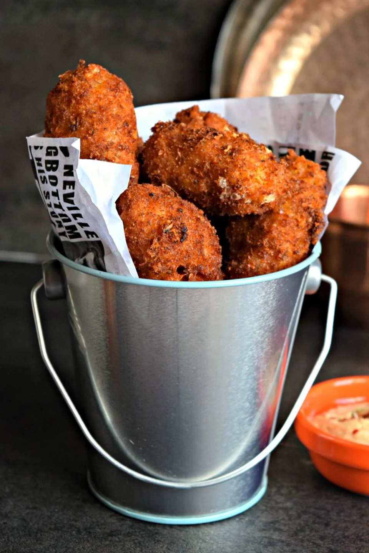 a bucket filled wih Cheesy Rice Vegan Kebabs