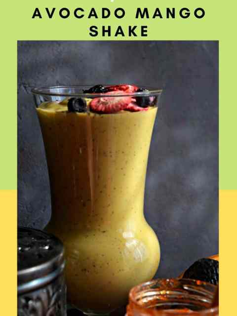 front view of a tall glass filled with Vegan Mango Avocado Smoothie with text at the top