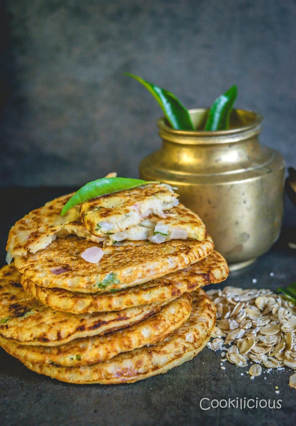 Healthy Oats & Veggie Mini Pancakes stacked up with a brass container in the background
