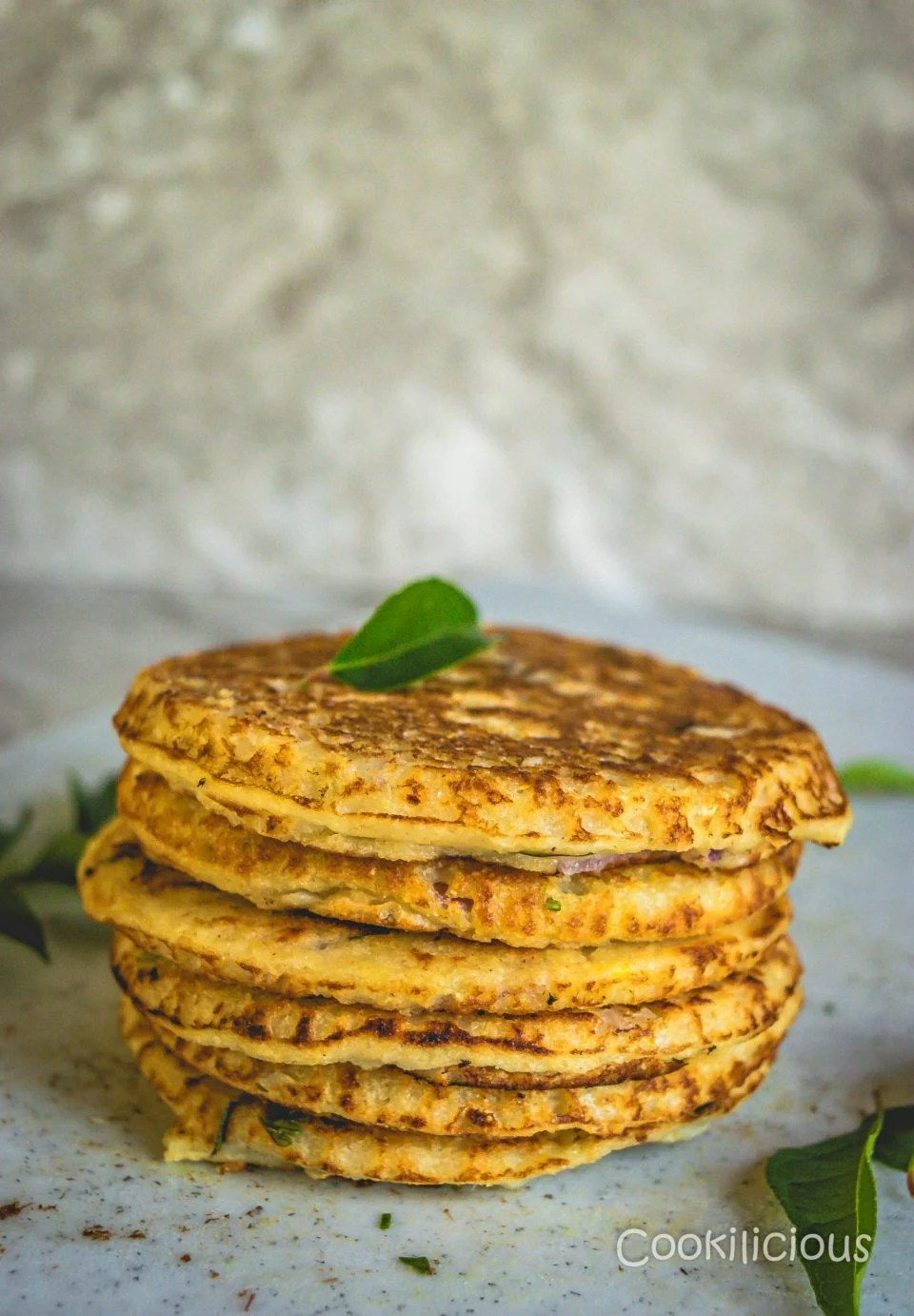 Healthy Oats & Veggie Mini Pancakes stacked one on top of the other