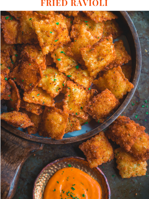 Copycat Olive Garden Cheesy Fried Ravioli in a tray with a dip on the side and text on top