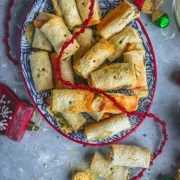 an oval plate filled with Baked Bread & Chutney Rolls with holiday decor around it