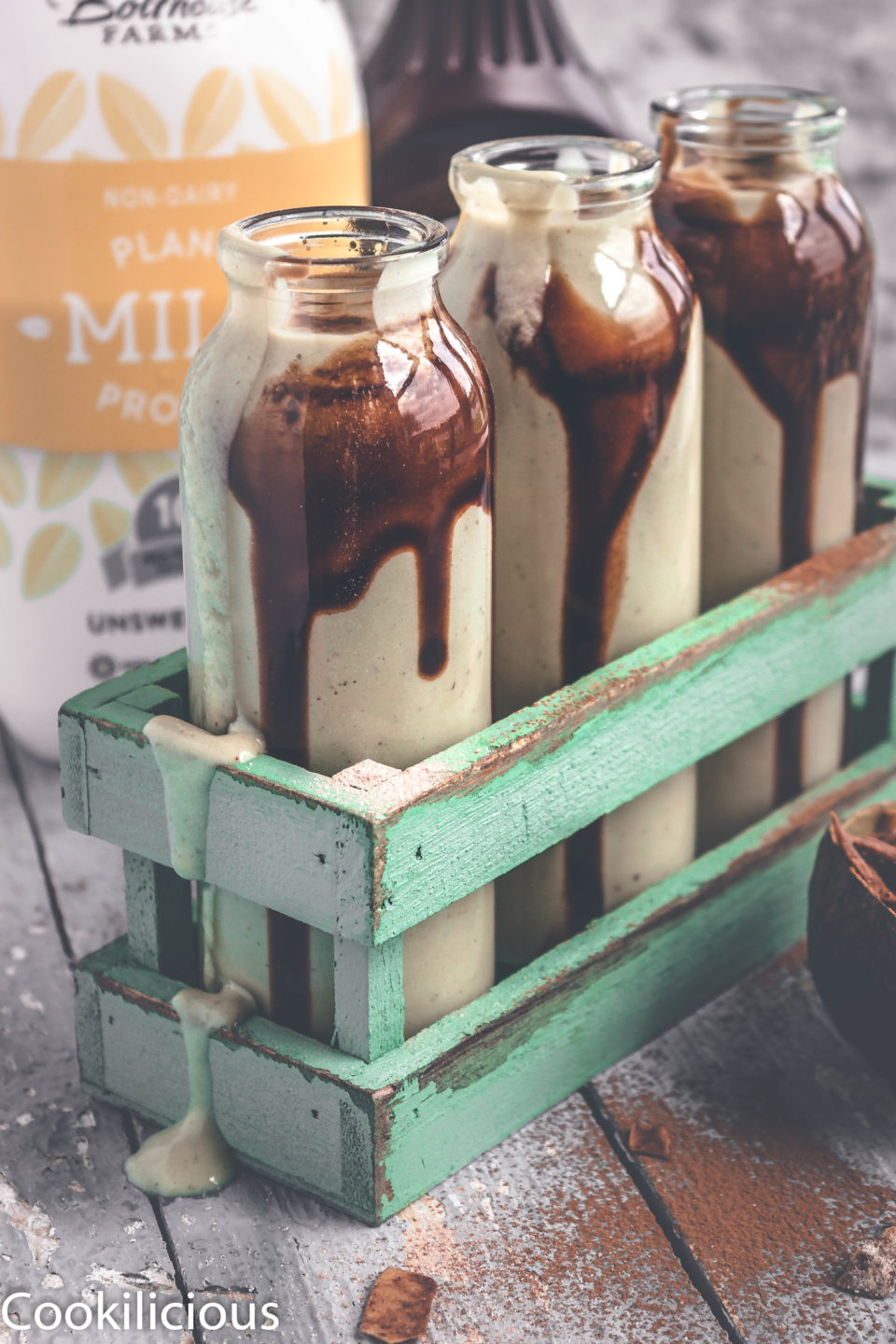 3 bottles of Chocolate Avocado Smoothie placed in a rack