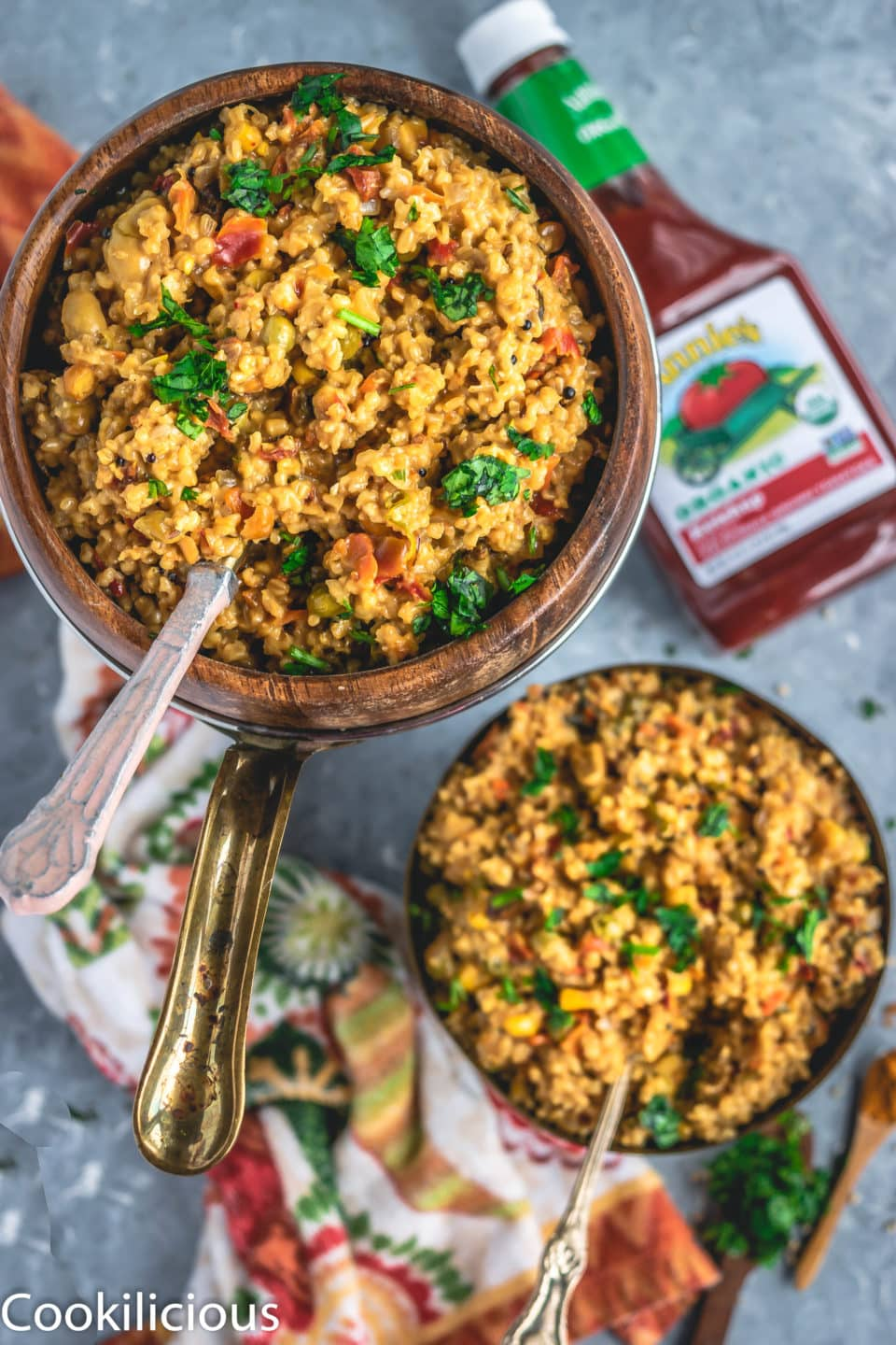 2 bowls of Instant Pot Oats & Vegetable Upma with a ketchup bottle on the side