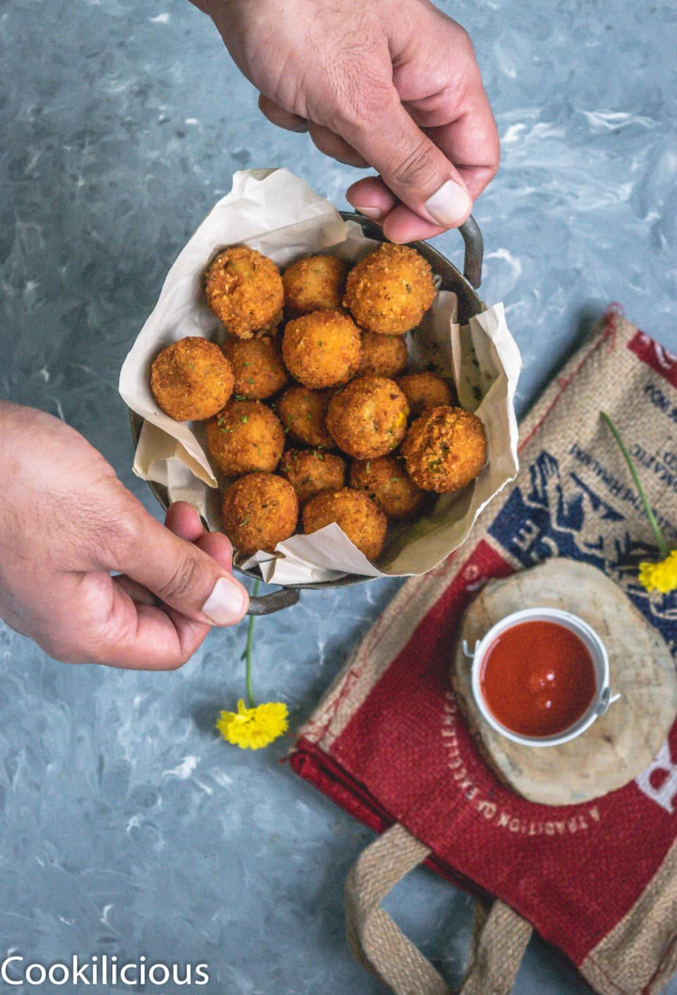 a set of hand holding a bowl of Semolina Vegetable Bites