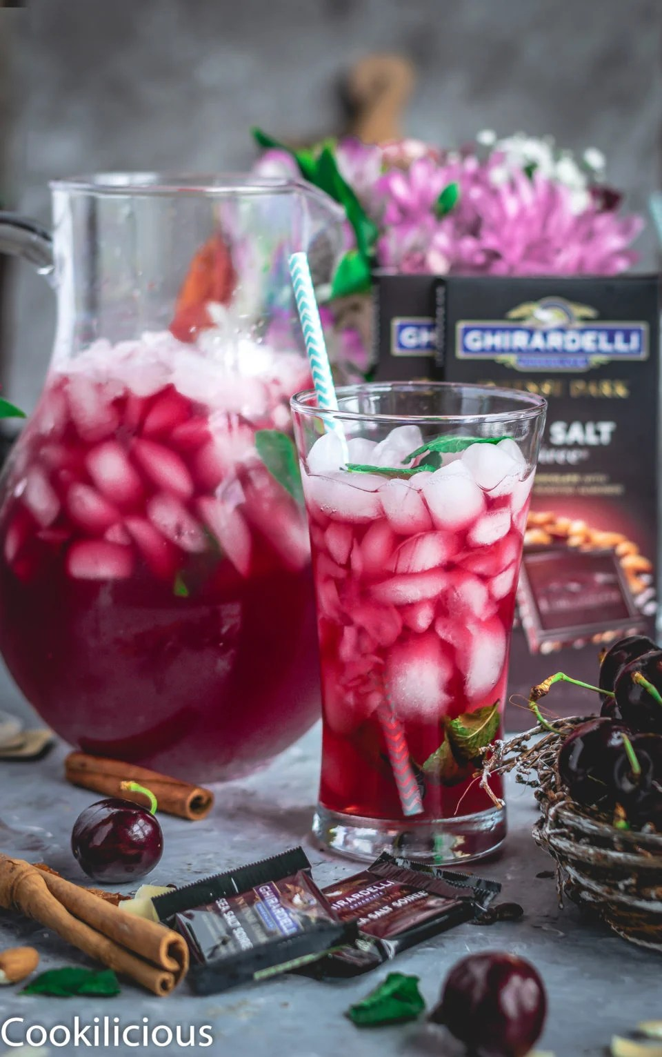 a glass pitcher and a glass both filled with Cherry Lemon Iced Tea