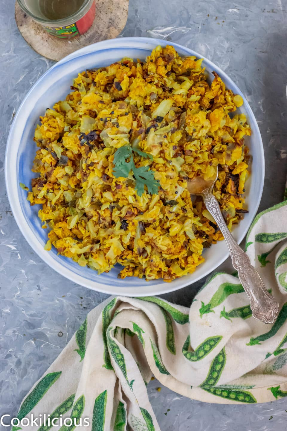 Cabbage & Chickpea Flour/Besan Stir-Fry in a bowl with a spoon in it