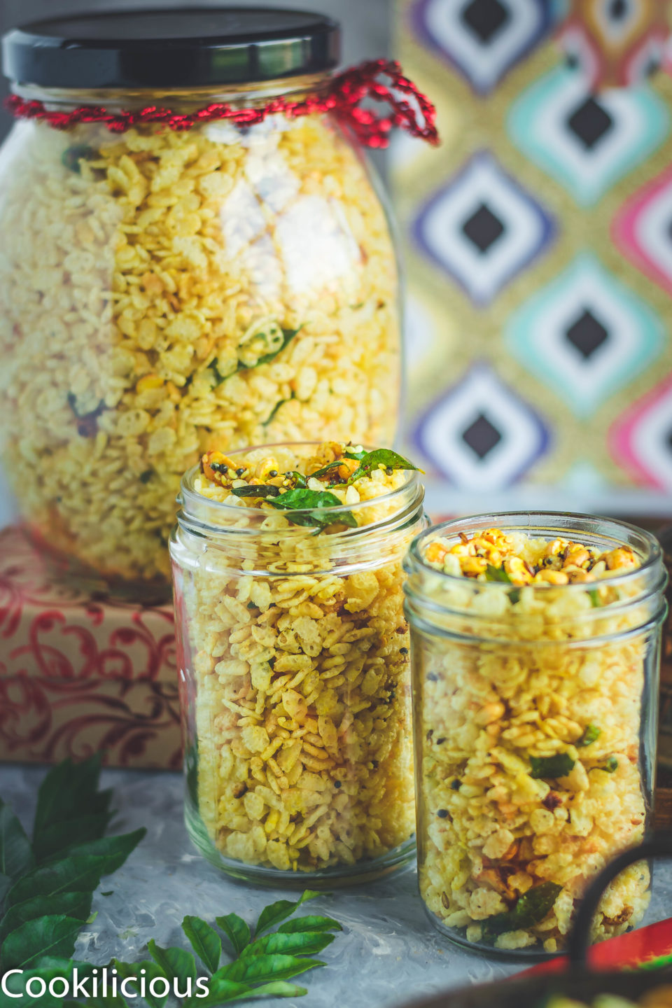 2 glass jars filled with Rice Krispie Chivda