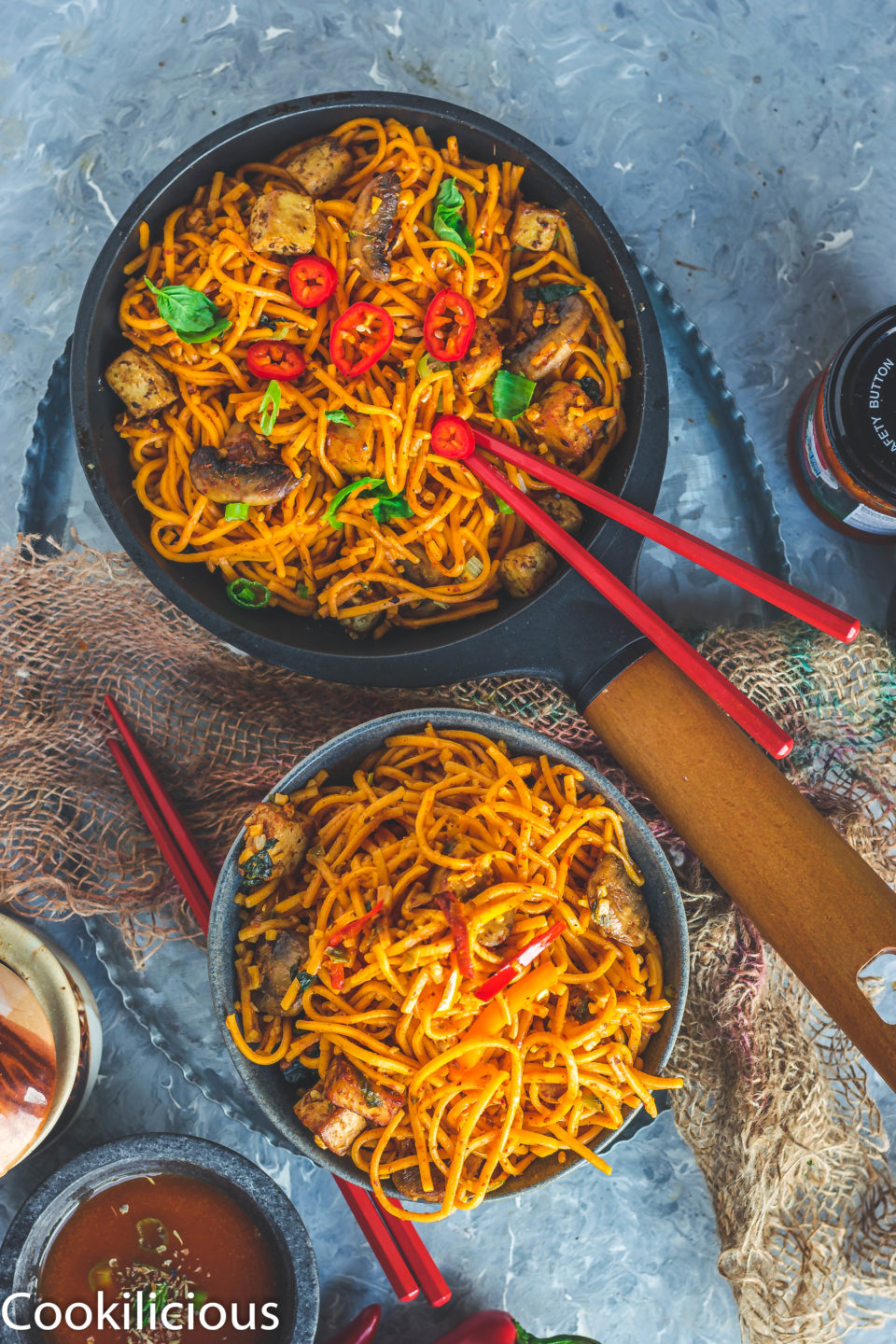 a pan & a bowl filled with Asian Style Thai Basil Tofu Stir Fry Noodles