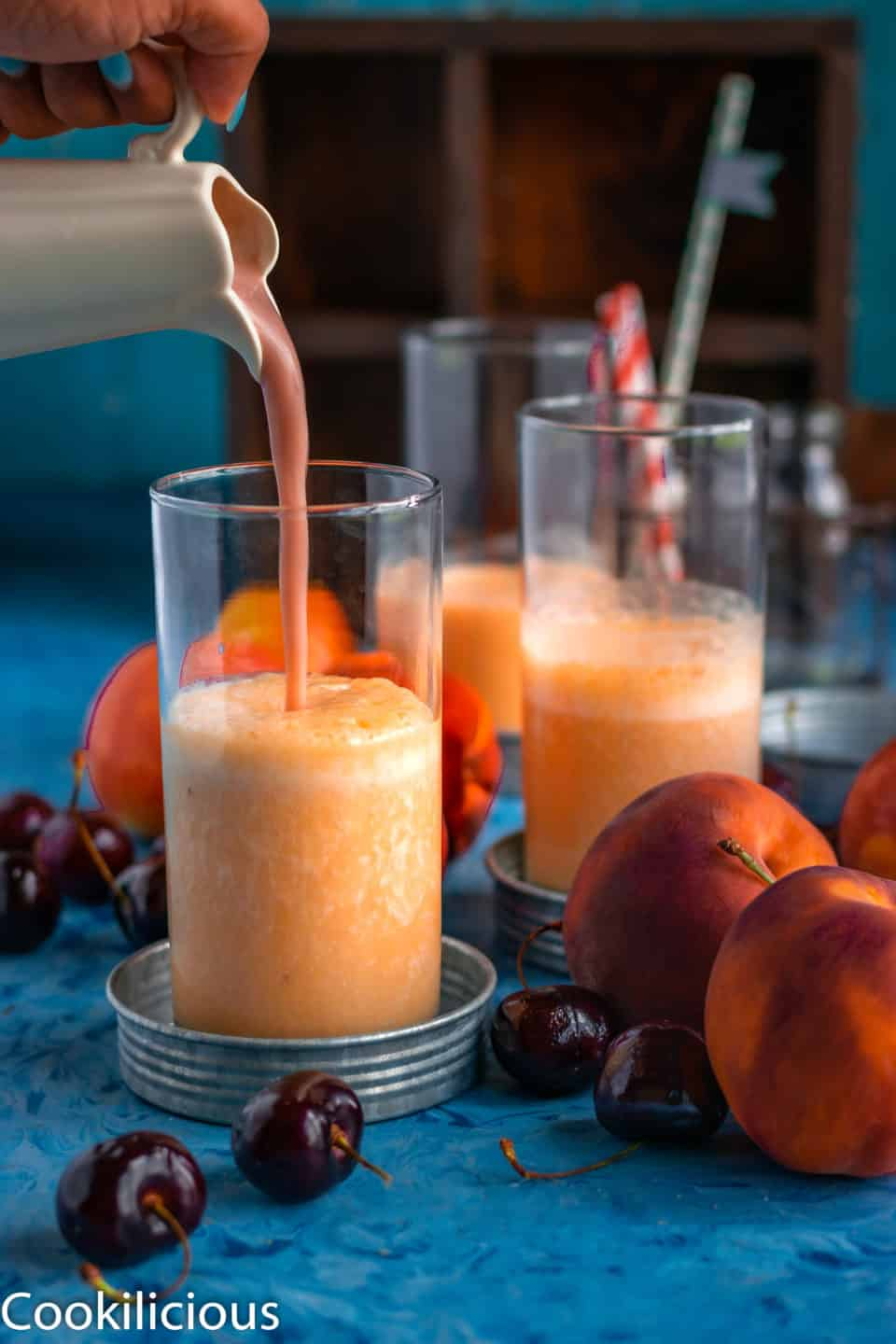 pouring shot of Peach & Raspberry Creamsicle Smoothie