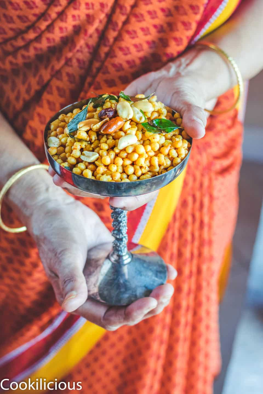 a set of hands holding a glass full of Kara Boondi Mixture