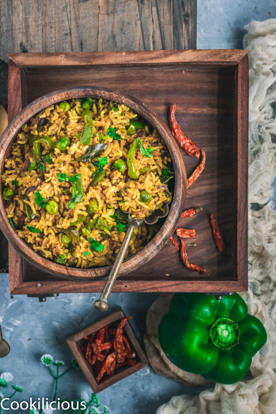 Bell Pepper Fried Rice in a bowl placed in a wooden tray