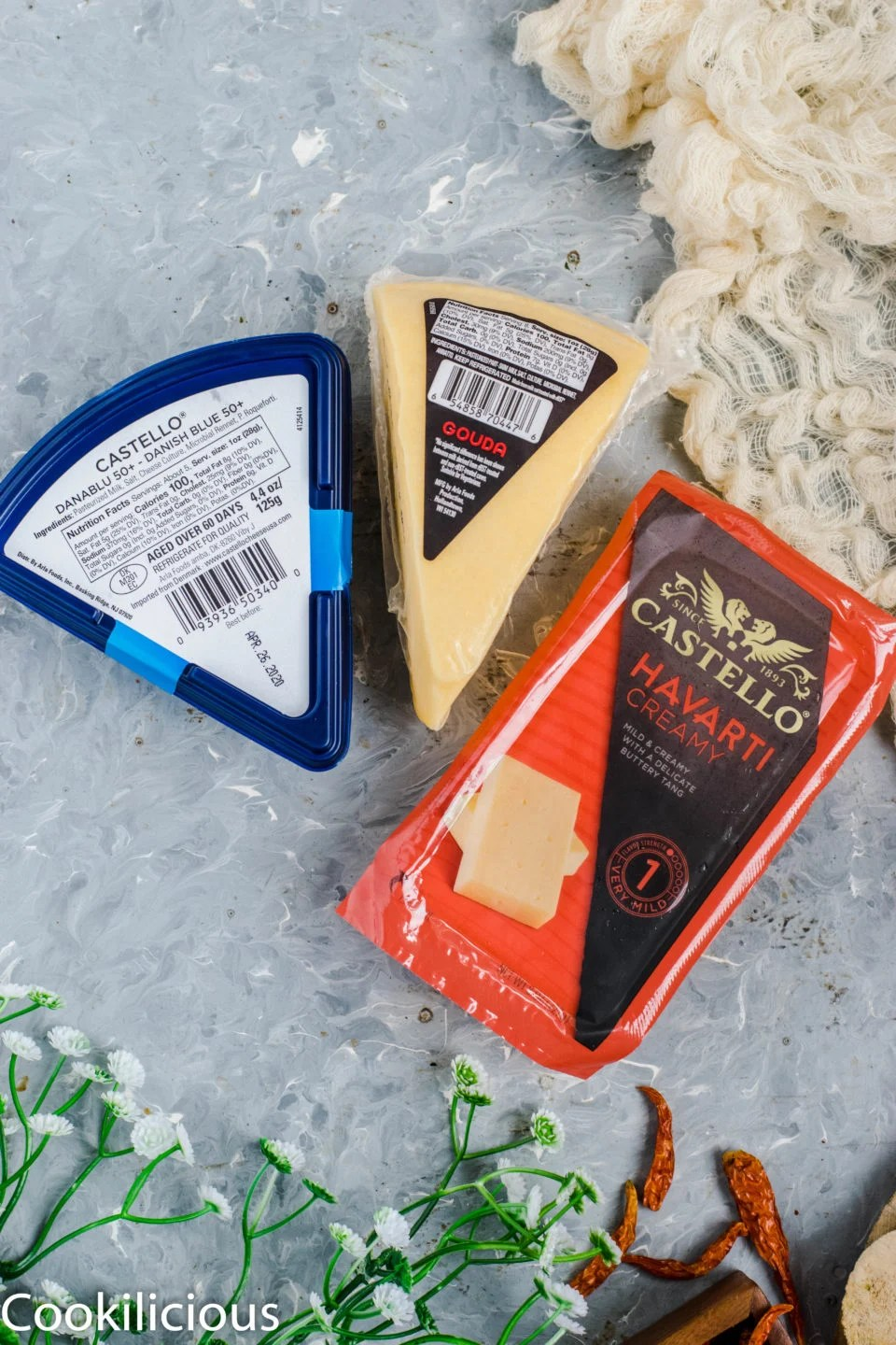 three varieties of cheese laid out