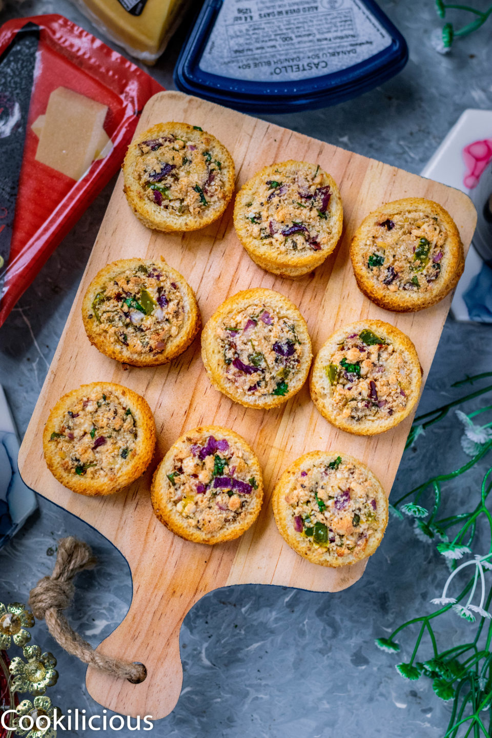 Baked Cheese Stuffed Bread Rings neatly arranged in a wooden tray