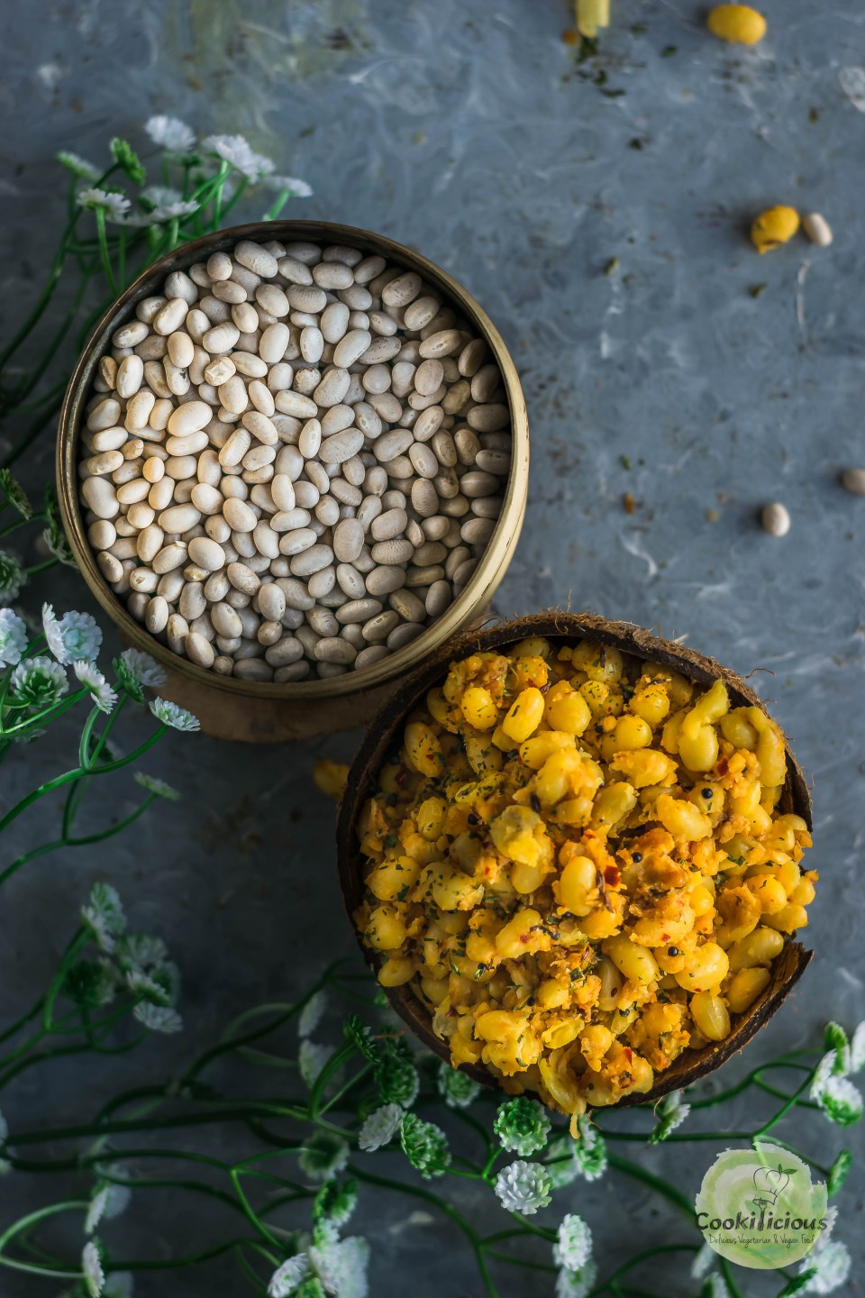 this Asian snack called navy beans sundal (a vegan salad) in a coconut shell besides a bowl of dry navy beans