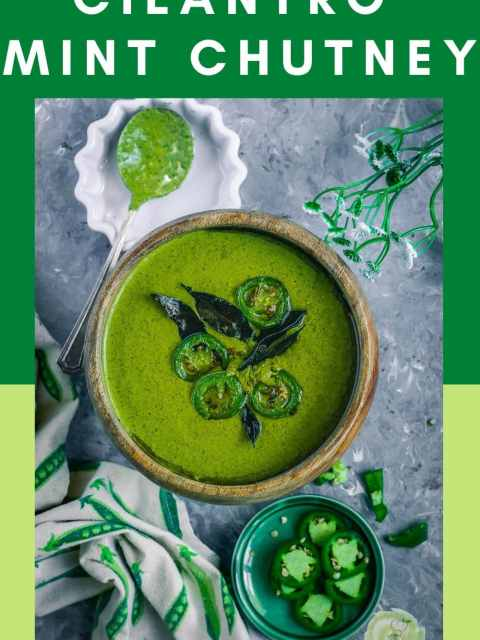 Mint Cilantro Chutney in a round bowl with sliced jalapenos on the side and a kitchen towel next to it and text at the top