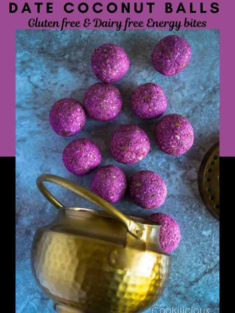 flat lay shot of Frozen Raspberry Date Coconut Balls fallen from a brass bowl with text at the top