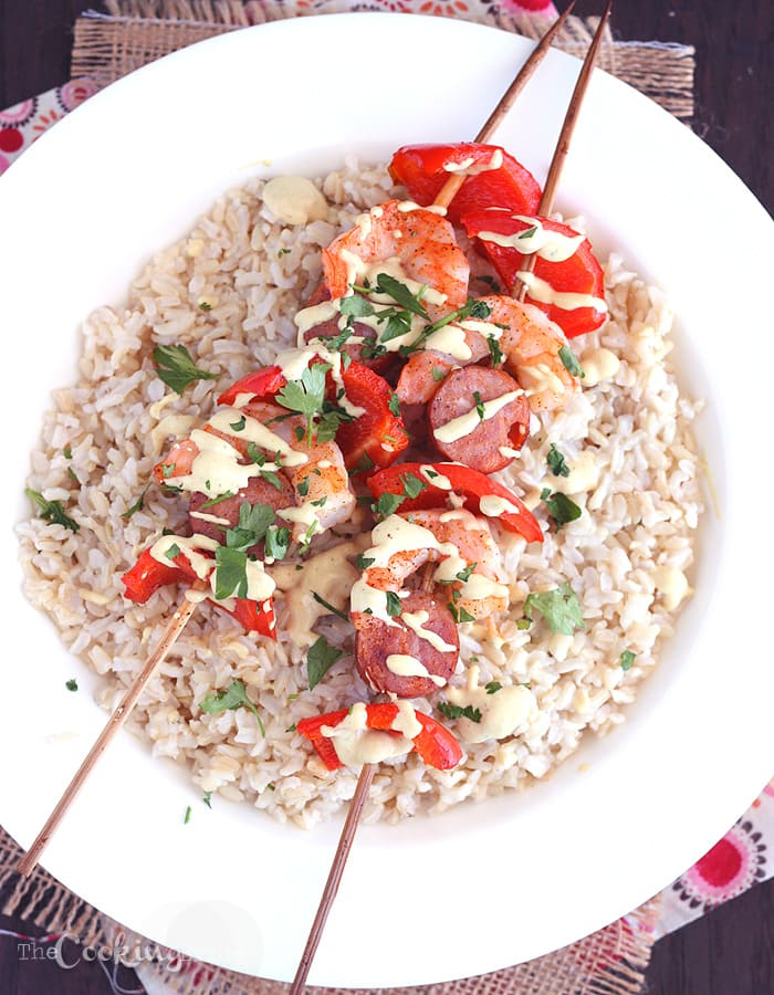 Andouille and Shrimp Kebabs on a bed of rice drizzled with sauce
