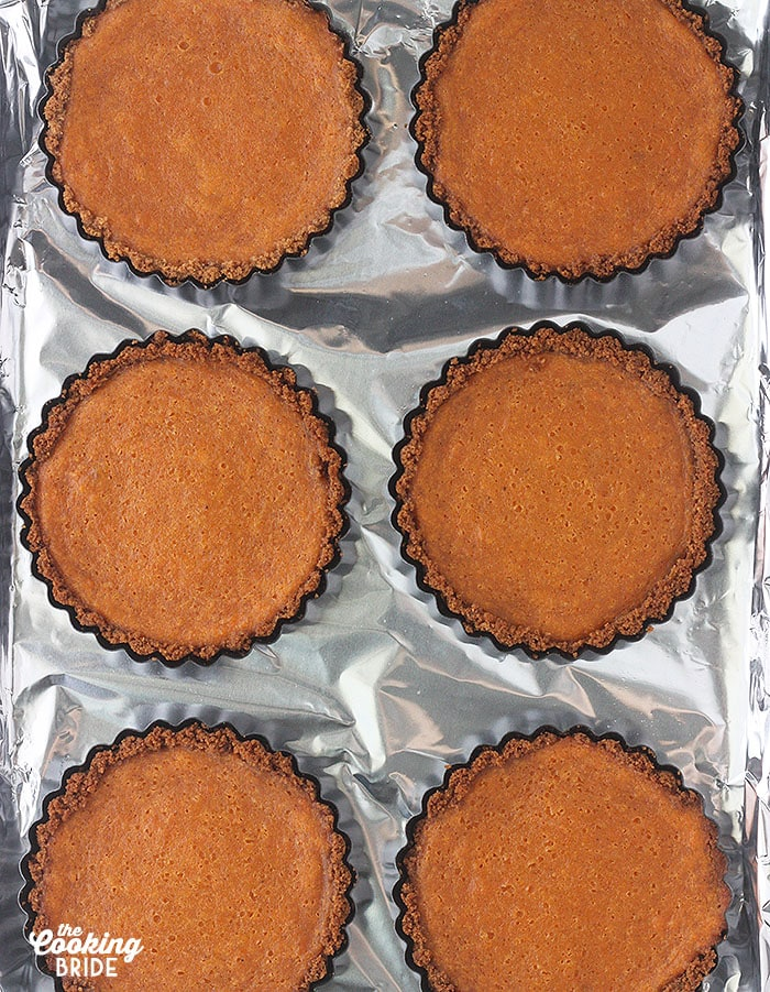 baked sweet potato tarts on a foil lined baking sheet