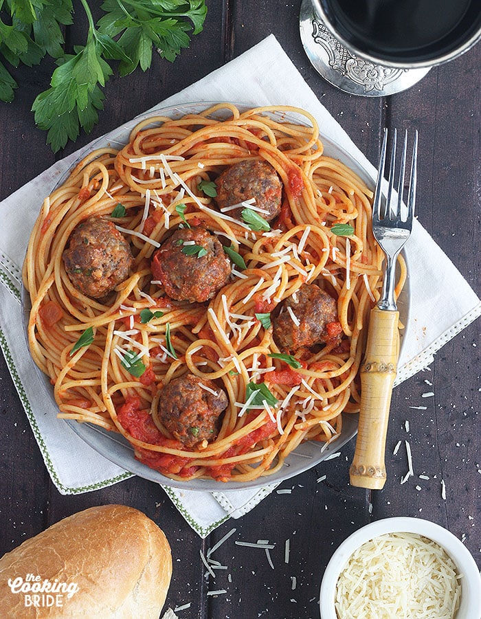 plate of pasta and tomato sauce topped with venison meatballs