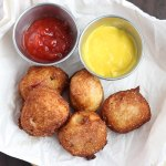 Mini corn dogs are a bite-sized version of a snack time favorite. Sliced hot dogs are coated in flour and cornmeal batter and fried until golden brown.