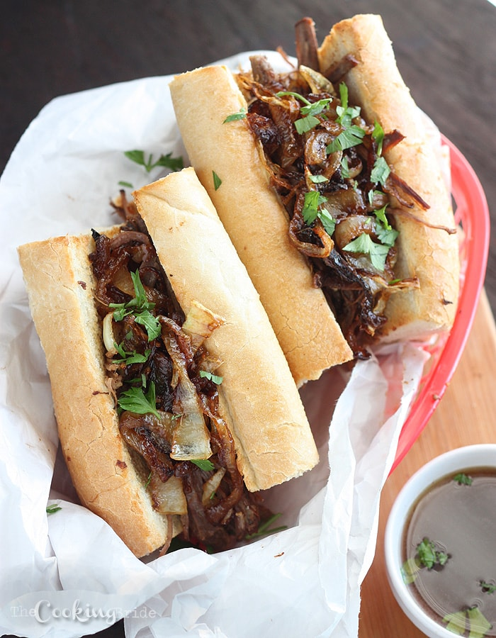 Rump roast is slowly simmered until tender and topped with onions in this tasty version of slow cooker French dip sandwiches.