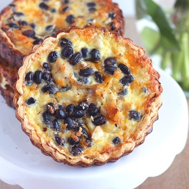 Looking for more hearty quiche fillings? Shredded chicken breast, black beans, and smoked cheddar make this a little more robust than your average quiche.