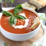 Warm up with the fresh flavors of this creamy tomato basil soup recipe. It's full of late summer bounty with fresh basil, sweet corn, and juicy tomatoes.