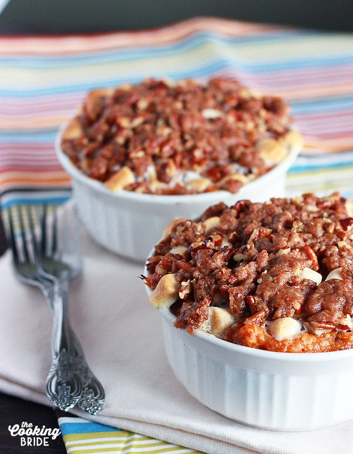 sweet potato casserole with pecans in white ramekins