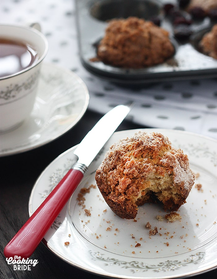 Festive holiday cranberry eggnog Christmas muffins are laced with tart cranberries, eggnog and topped with a sweet brown sugar streusel topping.