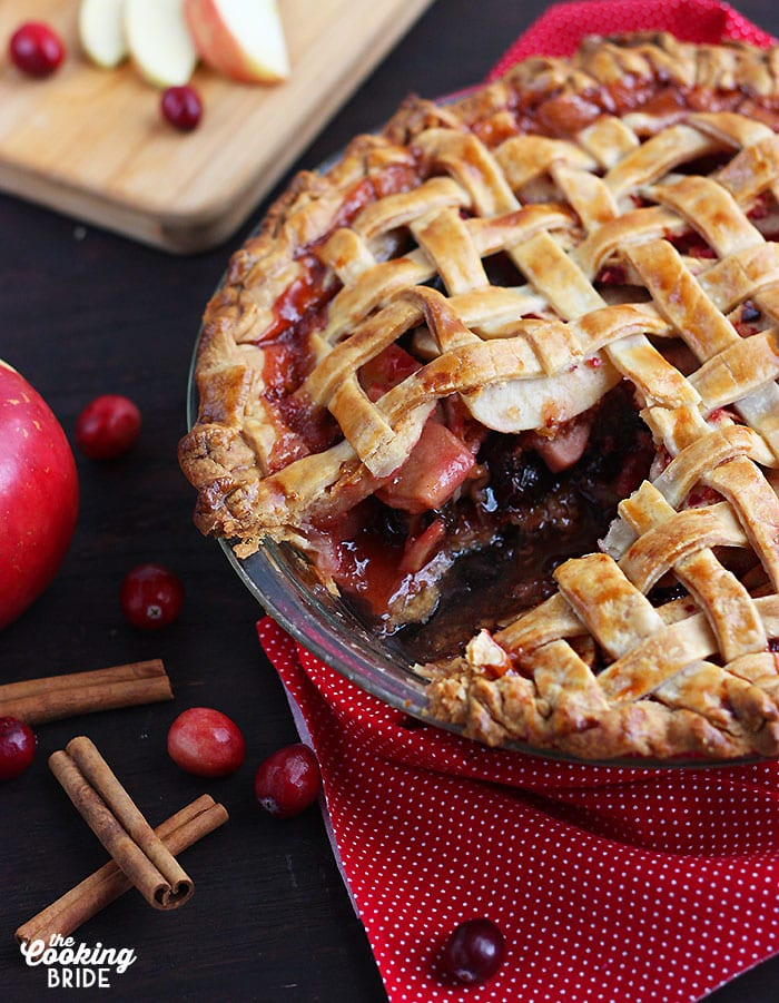baked cranberry apple pie with a slice cut out