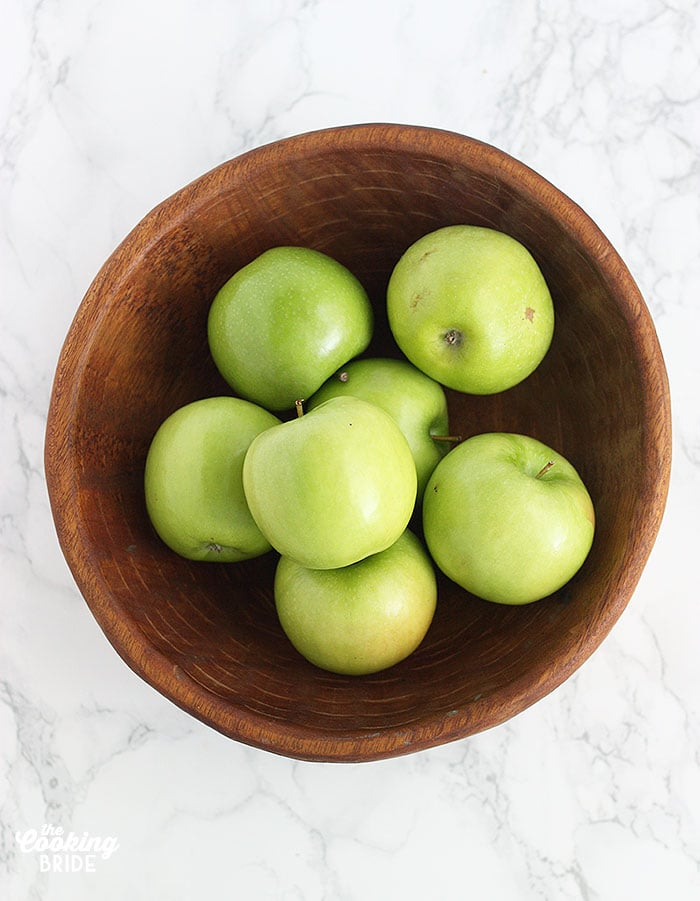 wooden bowl of granny smith apples