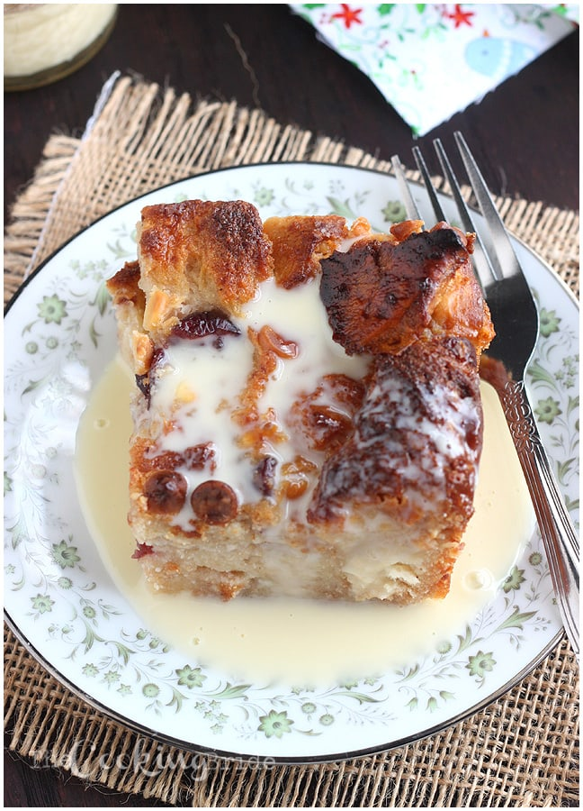 Bread pudding recipe is over the top delicious with dried cranberries and white chocolate chips and drizzled with warm rum creme anglaise sauce.