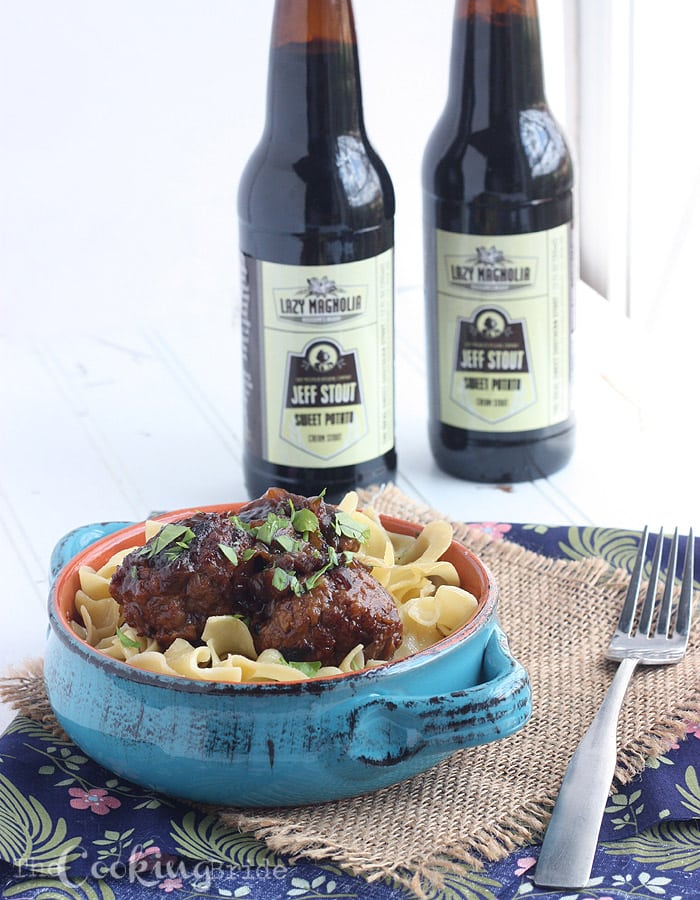 Tender beer braised pork meatballs are slowly simmer with thinly sliced onions in a dark stout gravy. Perfect comfort food!