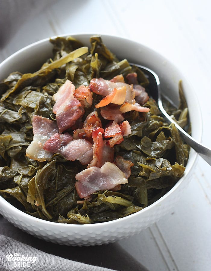 Try this set it and forget it recipe for slow cooker collard greens. Collards are slowly simmered with bacon until tender for a truly tasty Southern side.