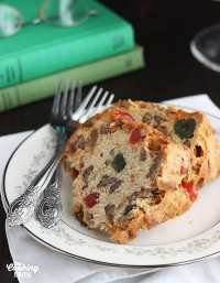 "Moist, white fruitcake is a little lighter than traditional dark fruitcake. This Southern version ""improved"" by dribbling it with bourbon instead of rum."