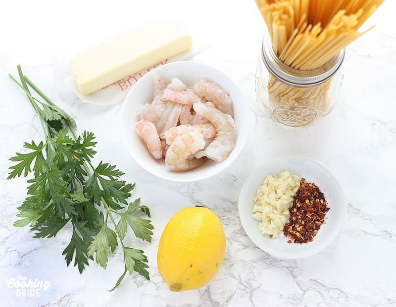 shrimp scampi ingredients on a white marble background