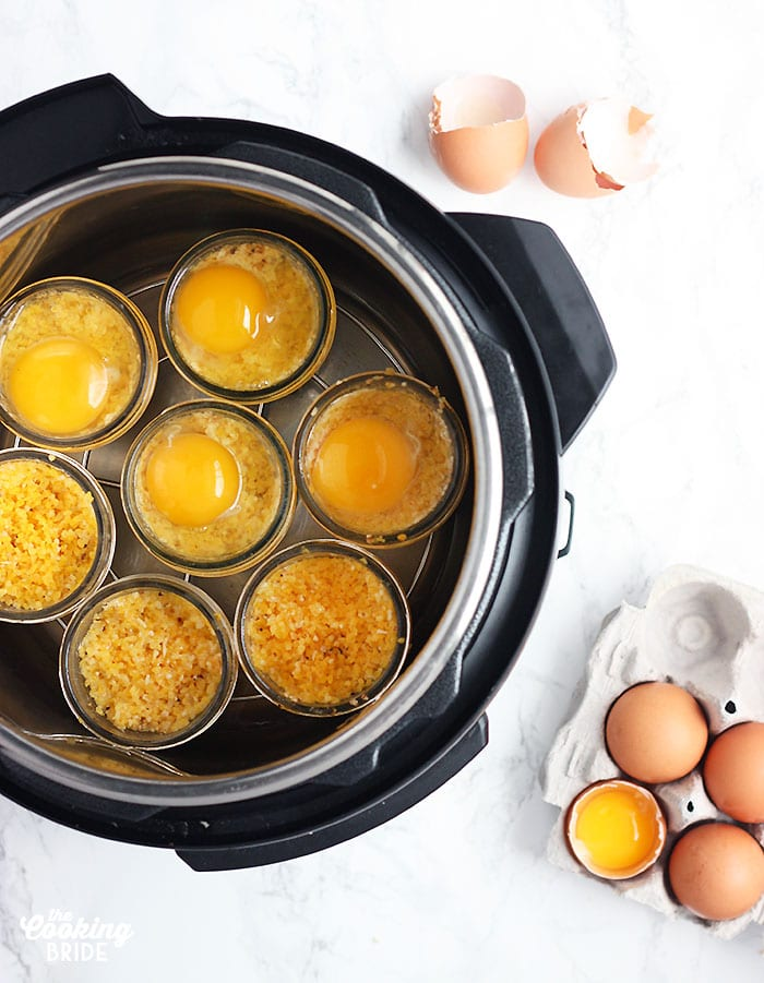 overhead shot of Instant Pot as eggs are being added to the jars