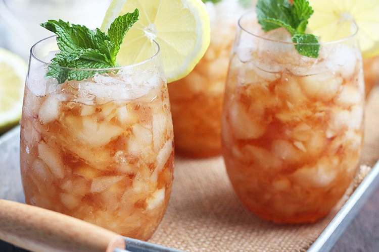 two sweet tea mint julep cocktails on a metal tray