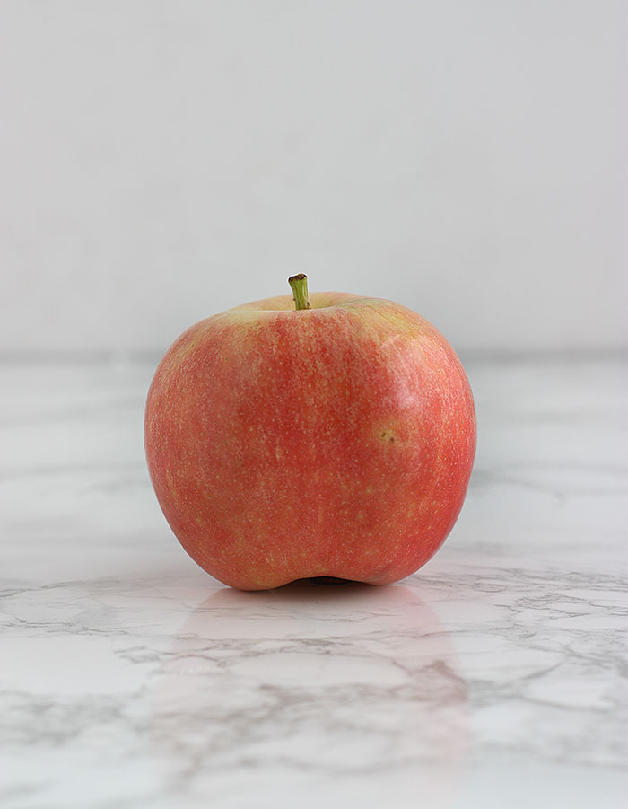 pink gala apple on a white background
