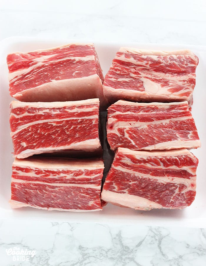 Raw shortribs on a white background