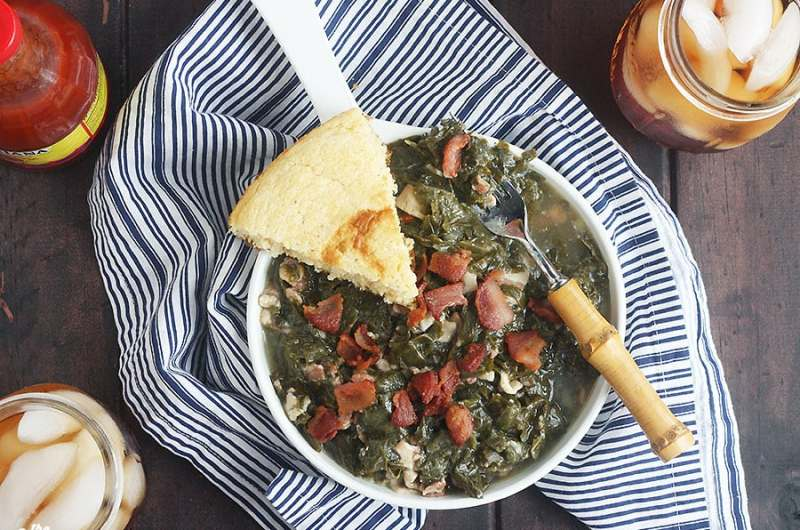 Learn how to cook turnip greens just like they do in the South. Greens are slowly simmered with pork jowl, apple cider vinegar, salt and pepper for a tender, tasty soul food side dish.