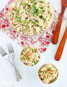 overhead shot of two servings of tuna macaroni salad in small blue bowls