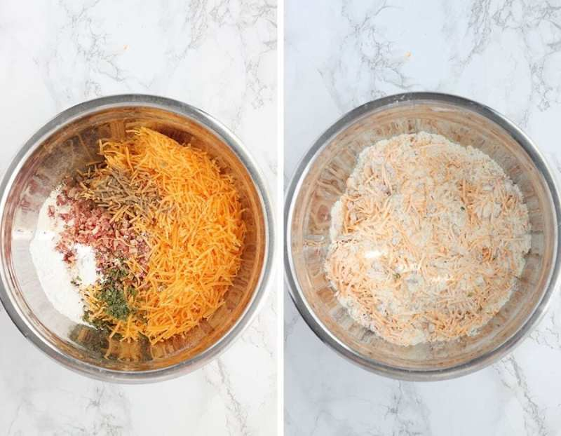 dry ingredients for cheese and bacon muffins in a metal mixing bowl.
