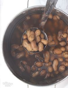 ladling boiled peanuts from a stock pot