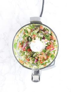 chopped vegetables in the bowl of a food processor