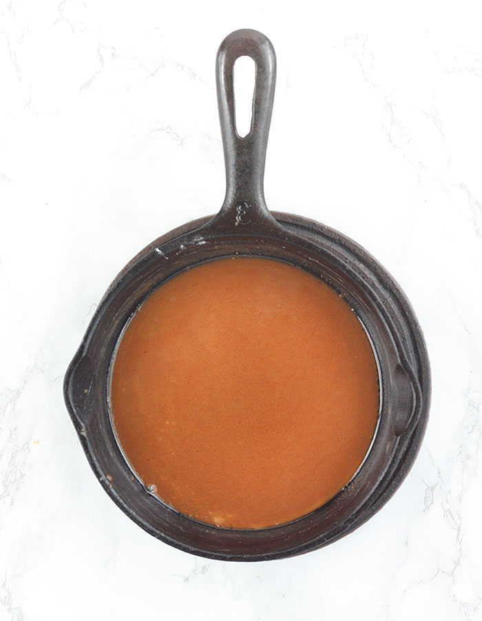 light brown roux in a cast iron skillet